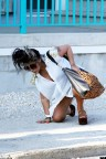 "Pregnant ""Jersey Shore"" star Nicole ""Snooki"" Polizzi takes a tumble in platform sandals in Seaside Heights"