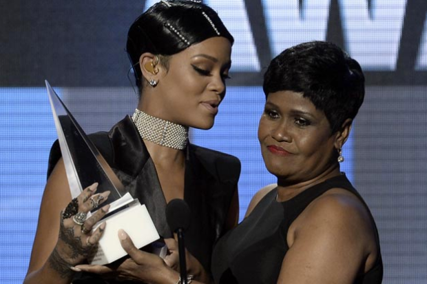 Rihanna Presented With AMA Icon Award By Mother
